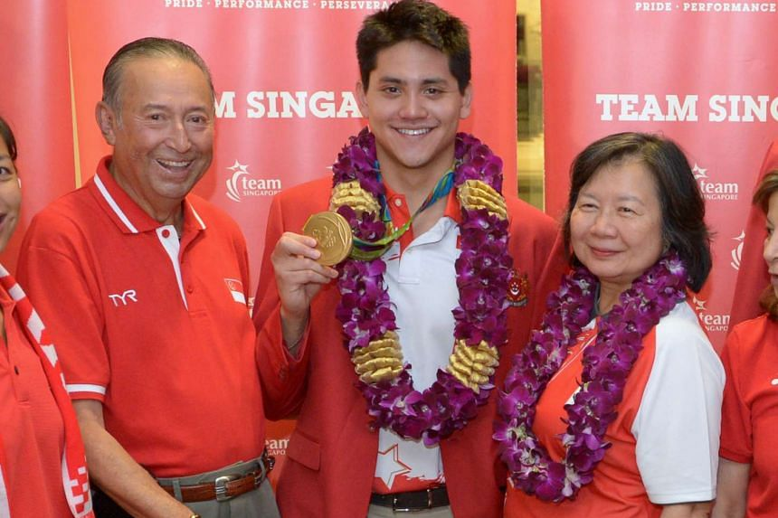 Joseph Schooling after returning to Singapore from the Rio Olympics on Aug 15, 2016 with his parents, Colin and May Schooling.