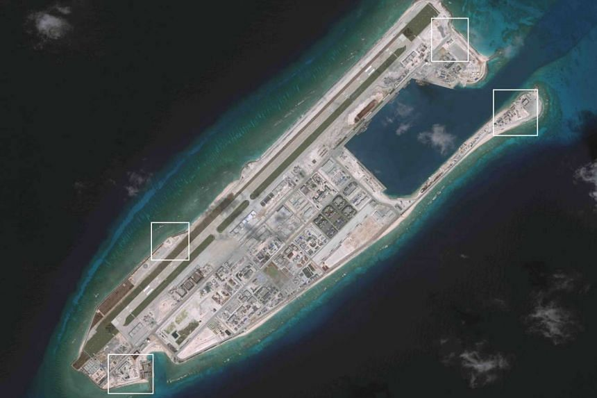 A satellite image showing appears to be anti-aircraft guns and close-in weapons systems (CIWS) on the artificial island Fiery Cross Reef.