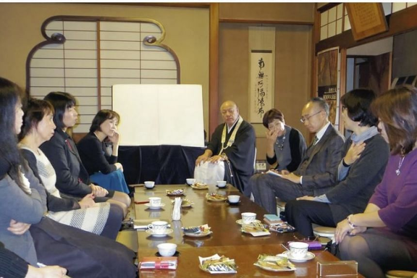 """Participants in a """"death cafe"""" sharing their feelings in Bunkyo ward, Tokyo."""