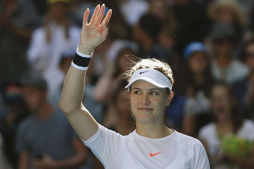 Canada's Eugenie Bouchard celebrates winning her Women's singles second round match against China's Peng Shuai, on Jan 18, 2017.