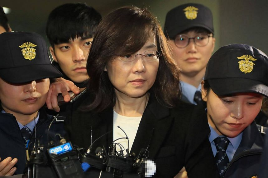 South Korea's former culture minister, Cho Yoon Sun (centre), is escorted by police following her arrest in Seoul, on Jan 21, 2017.