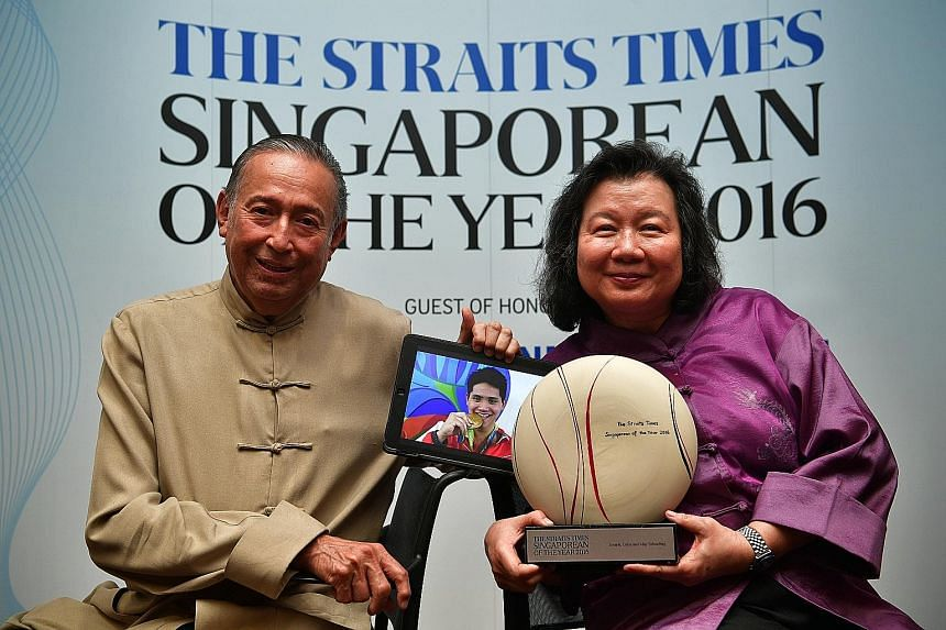 Colin and May Schooling with The Straits Times Singaporean of the Year 2016 award and an Olympic picture of Joseph during the award ceremony yesterday. Guests were told to come in festive dress, since the event was held during the Chinese New Year pe