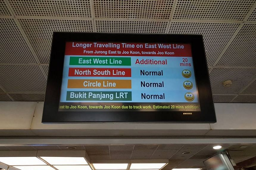 A screen informing commuters of the East-West Line delays.