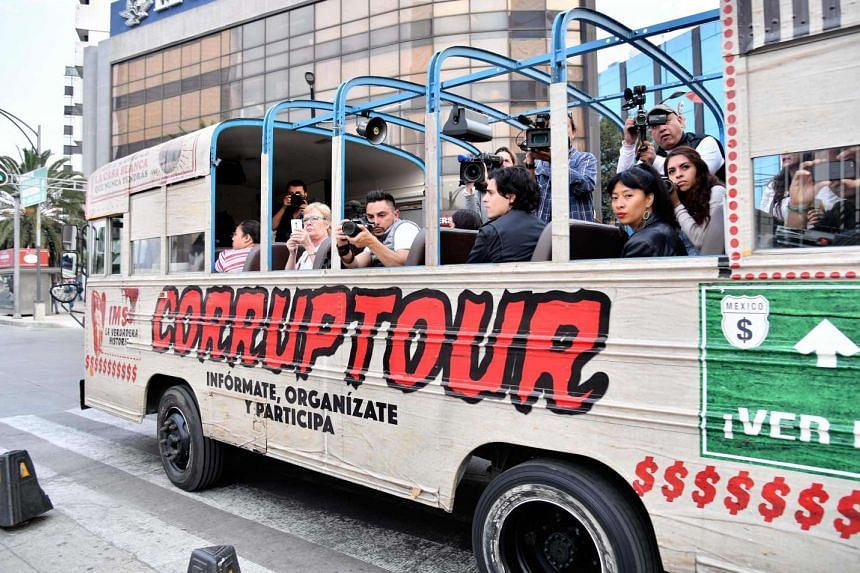 Tourists ride  the Corruptour bus in Mexico City on Feb 5.