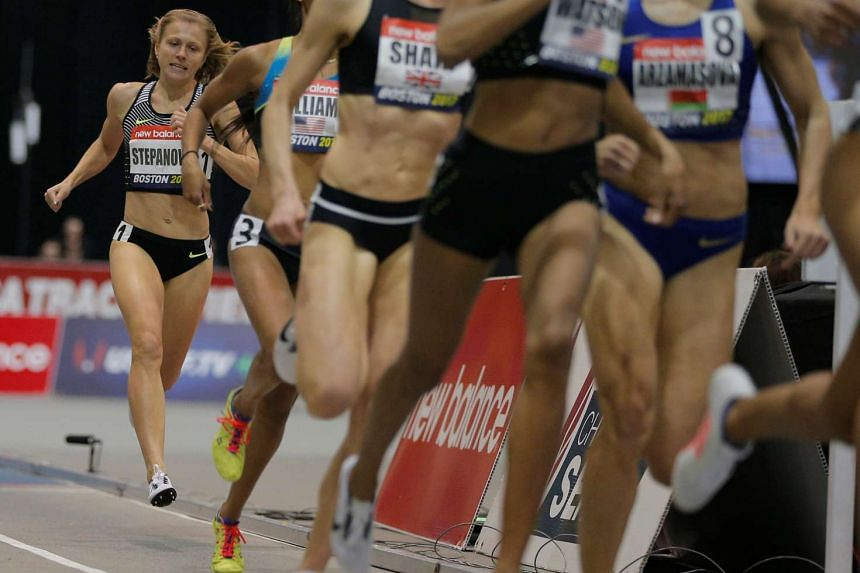 Russian runner Yulia Stepanova (right), who helped expose massive doping problems in Russia, races in Boston on Jan 28, 2017.