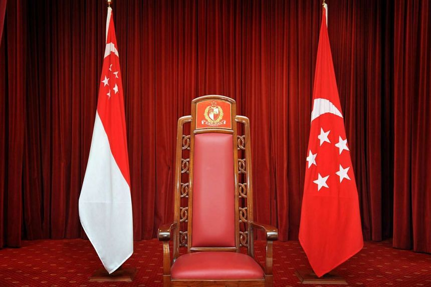 The Presidential chair flanked by the State Flag (left) and the Presidential Standard (right) at the Istana.
