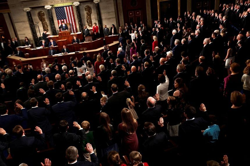 Members of the US House of Representatives are sworn in on the House floor on the first day of the new session of Congress.