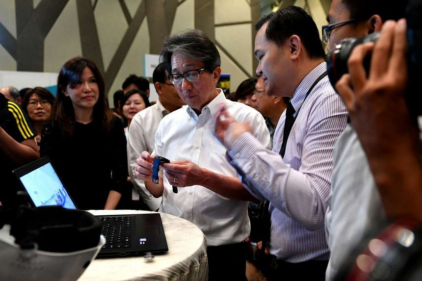 A smartwatch from Sats Technical Ramp being shown to Manpower Minister Lim Swee Say during the career fair on Feb 8, 2017.