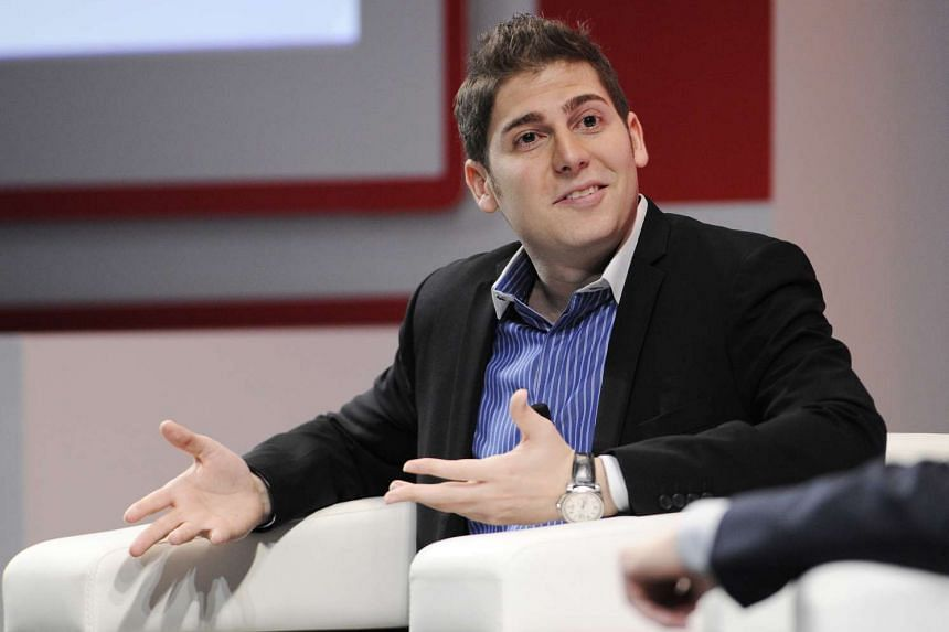 Eduardo Saverin, co-founder of Facebook Inc., speaks during a Wall Street Journal Unleashing Innovation event in Singapore.