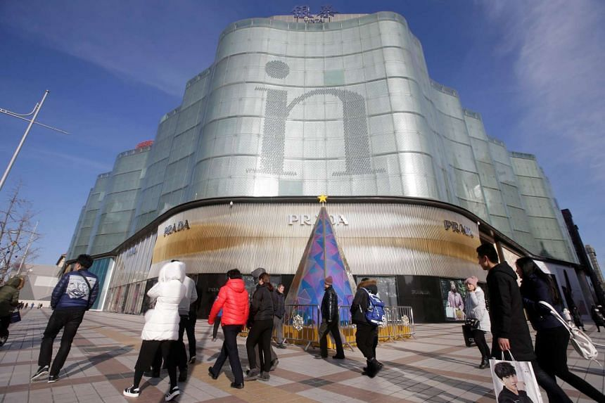 People walk outside an Intime Lotte department store in downtown Beijing, China on Jan 10, 2017.
