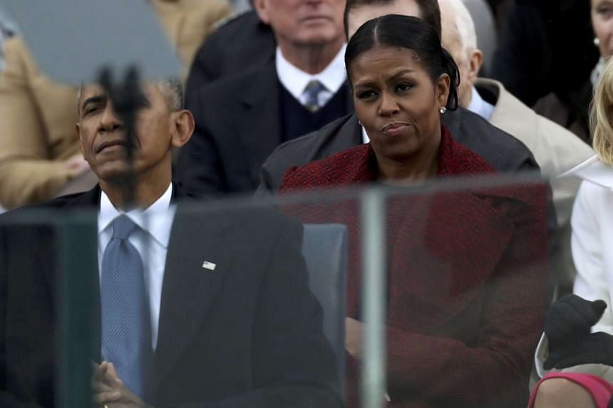Michelle Obama listens during incoming president Donald Trump's inauguration speech in Washington, Jan 20, 2017.