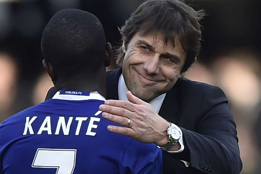 Chelsea manager Antonio Conte and N'Golo Kante celebrating after Saturday's 3-1 home victory over Arsenal.