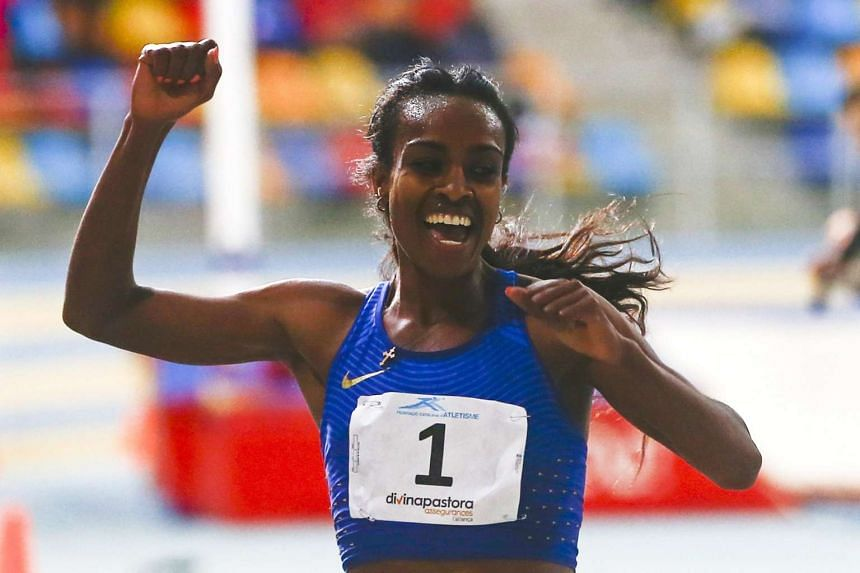 Ethiopia's Genzebe Dibaba celebrates after setting a new world record in the women's 2,000m race.