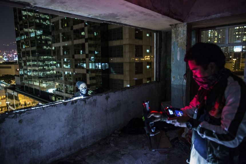 Members of HK Urbex in an abandoned building in Hong Kong's Tai Kok Tsui district, on Dec 16, 2016.