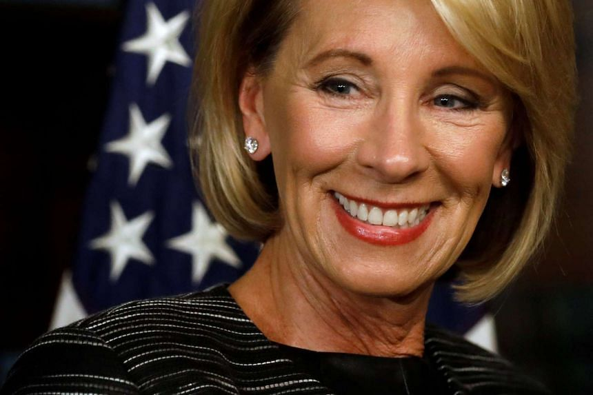 Betsy DeVos waits to be sworn-in as US Education Secretary at the Eisenhower Executive Office Building at the White House.