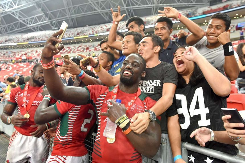 Kenya's Samuel Oiech and his team-mates meet fans after winning the Singapore Rugby 7s at the National Stadium on April 17, 2016.