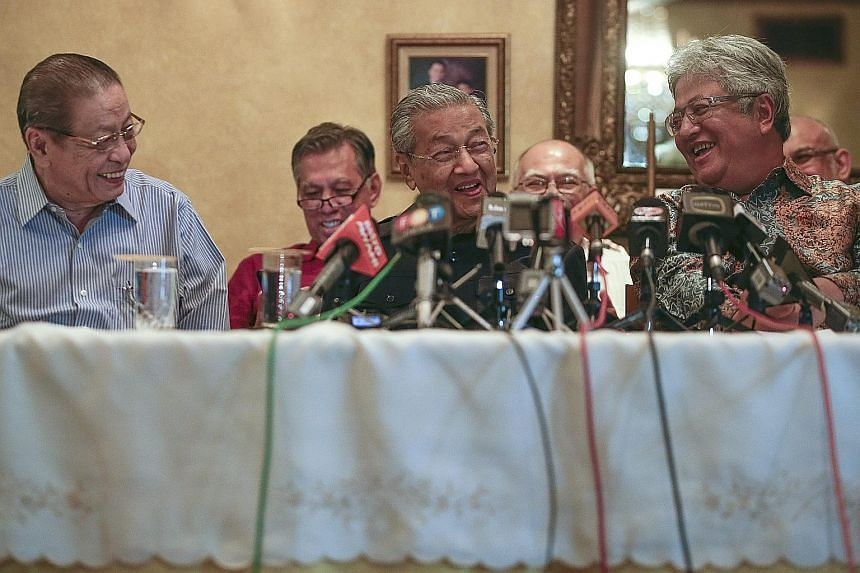 (From left) DAP stalwart Lim Kit Siang, Tun Dr Mahathir Mohamad and former law minister Zaid Ibrahim at yesterday's press conference, when Mr Zaid announced that he was joining the Chinese-majority DAP. Leaders of the opposition party said they have