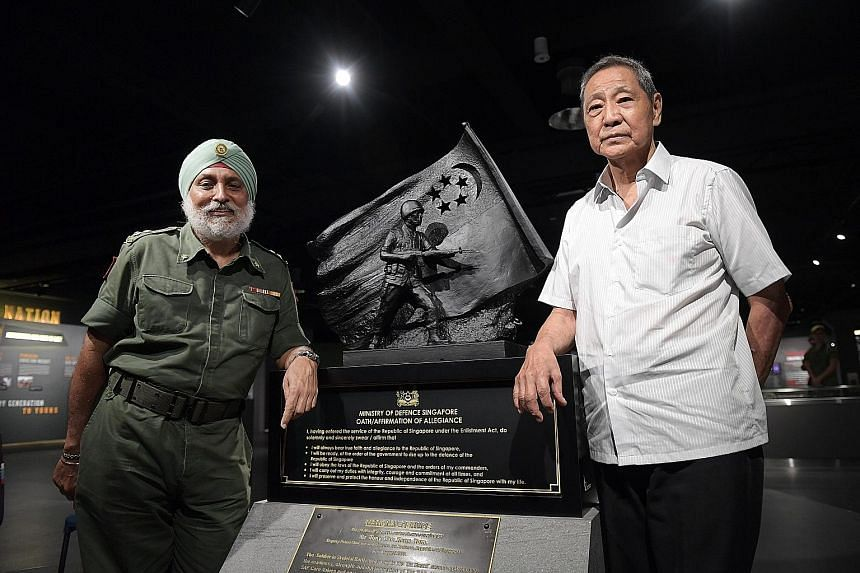 Retired senior warrant officer Ong Hui Pheng with one of his trainees, retired lieutenant-colonel Albel Singh, who was first in line to register for NS in March 1967.