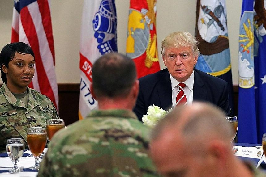 US President Donald Trump visiting the US Central Command headquarters in Tampa, Florida, on Monday. During the visit, he accused the media of downplaying the terror threat his administration cites to justify its travel ban.