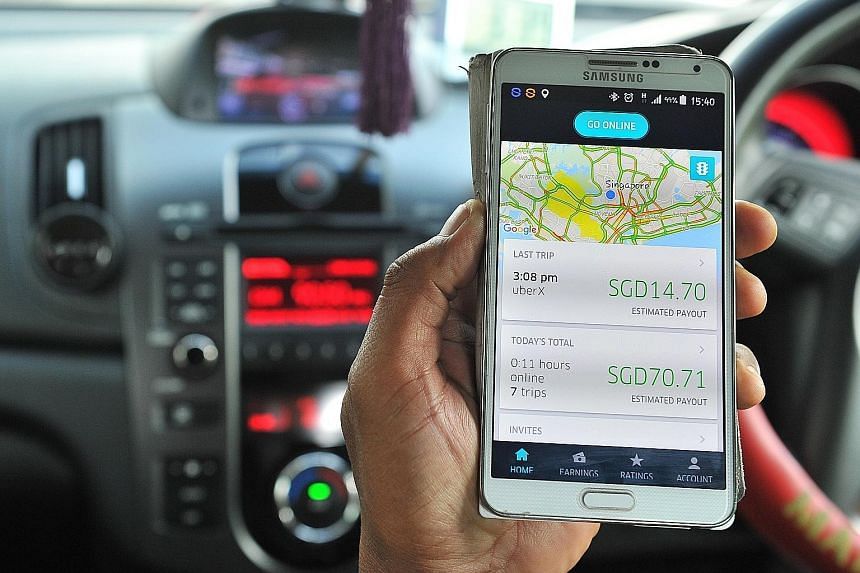 The Uber driver app on a phone. Under new rules, cars used for services such as those provided by Uber and Grab must display decals identifying them as private-hire vehicles.