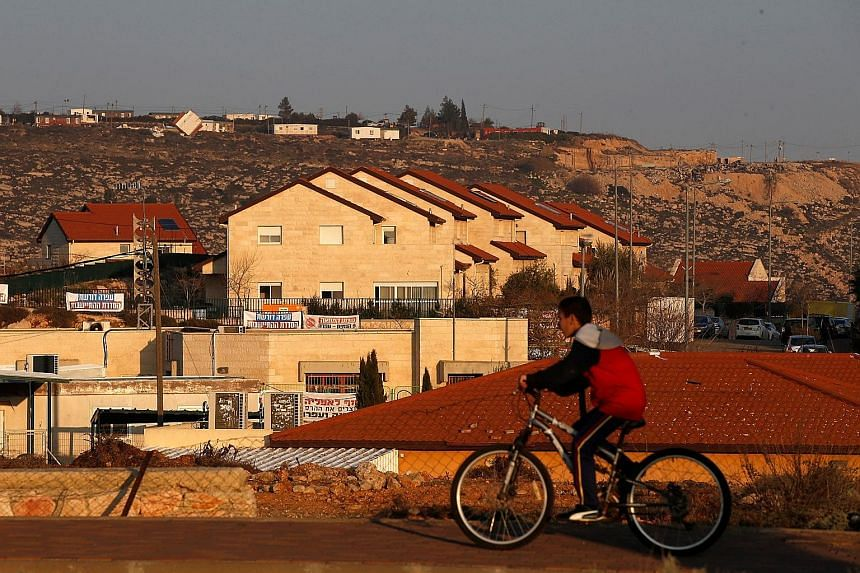 Israel has passed a law retroactively legalising about 4,000 settler homes built on privately owned Palestinian land in the occupied West Bank. However, the law contravenes Israeli Supreme Court rulings on property rights.