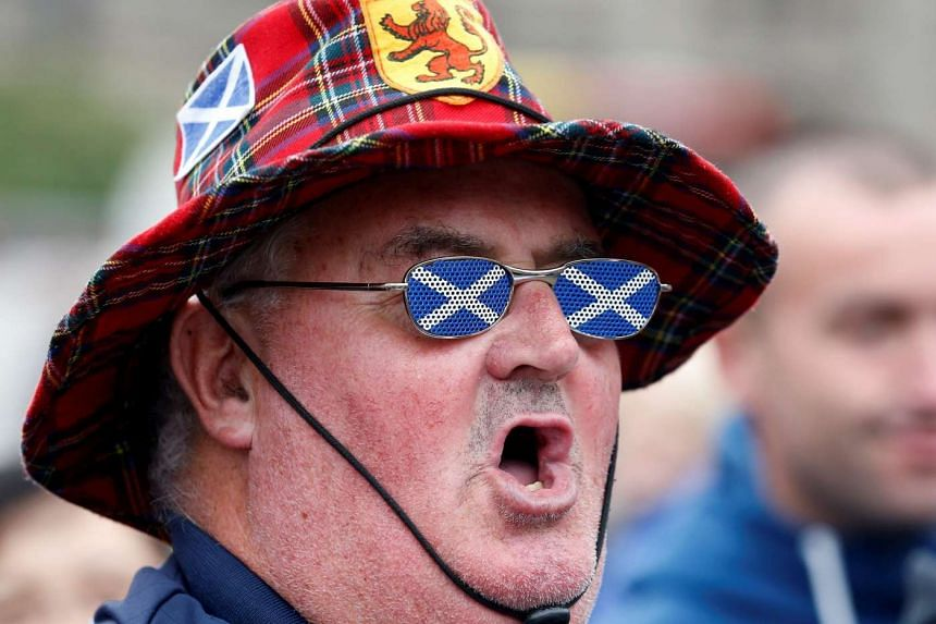 "A supporter of the ""Yes"" campaign reacts in George Square after the referendum on Scottish independence in Glasgow, Scotland on Sept 19, 2014."