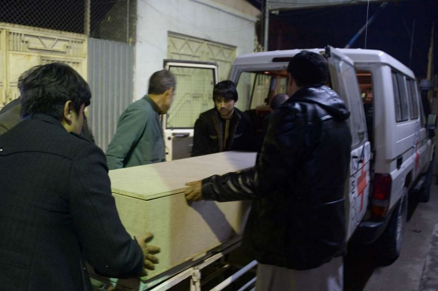 Afghan men unload a coffin of an International Committee of the Red Cross employee, who was killed by gunmen in Jwzjan province, at a hospital in Mazar-i-Sharif, Afghanistan on Feb 8, 2017.