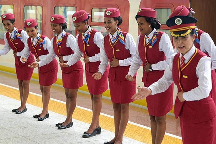 Chinese conductor Ding Jihua (at right) trains Ethiopian attendants at a station in Addis Ababa. The railway system will be turned over to local citizens in five years' time.
