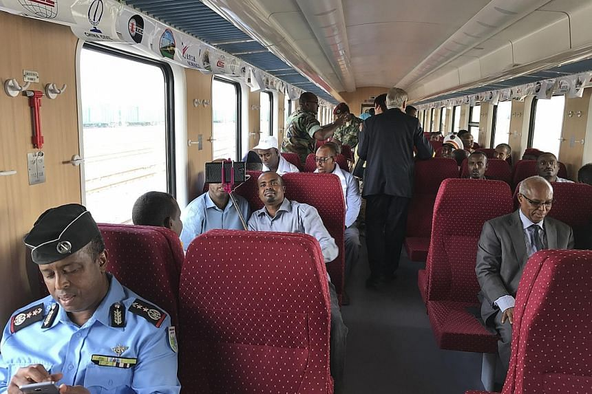 Passengers on board the first electric, transnational train in Africa, which has seen relatively little new railway construction in a century, during its inaugural journey from Djibouti to Addis Ababa on Jan 10.