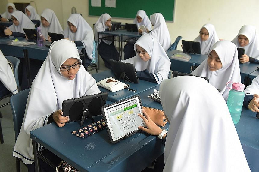 An Arabic class conducted with iPads at Madrasah Aljunied Al-Islamiah on Tuesday. Most learners of modern standard Arabic are in religious schools. Mr Adni Aljunied, a fifth-generation Singaporean of Arab descent who owns the Malay Art Gallery, says