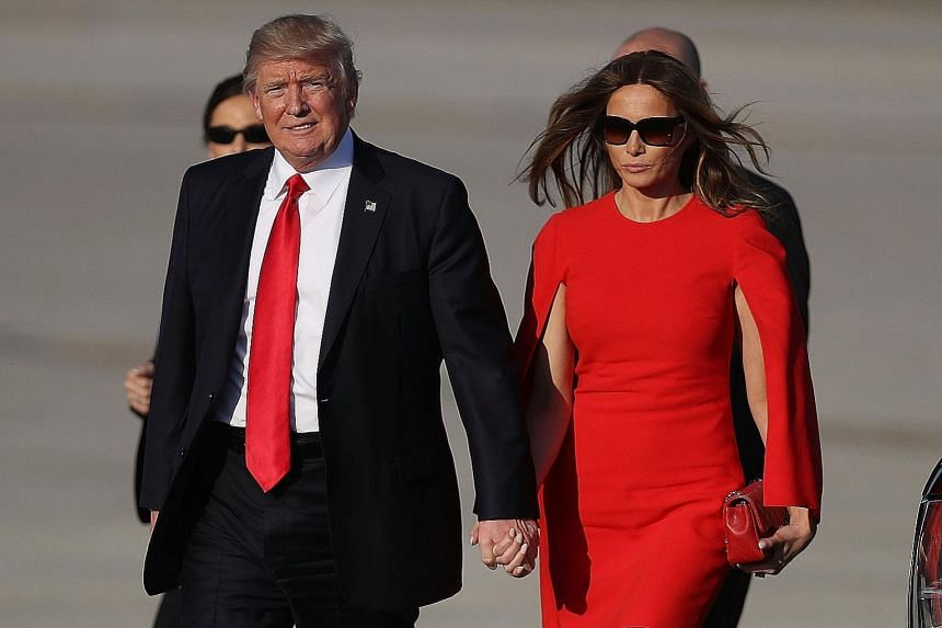 Above: Mrs Melania Trump (with United States President Donald Trump) dressed in a long hot-pink gown from Christian Dior to a Red Cross ball last Saturday. Left: She wore a red Givenchy cape dress to complement his tie as well as mark National Wear R