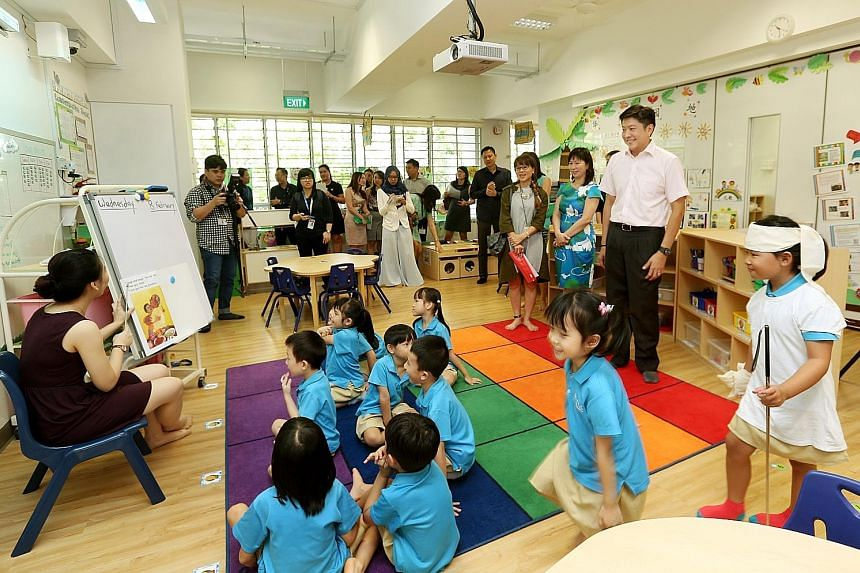 Education Minister (Schools) Ng Chee Meng (far right) visiting the MOE Kindergarten @ Punggol View yesterday, with Ms Panmeline Wong, head of the centre, beside him. To be set up in Punggol next year, the three new MOE kindergartens will be co-locate