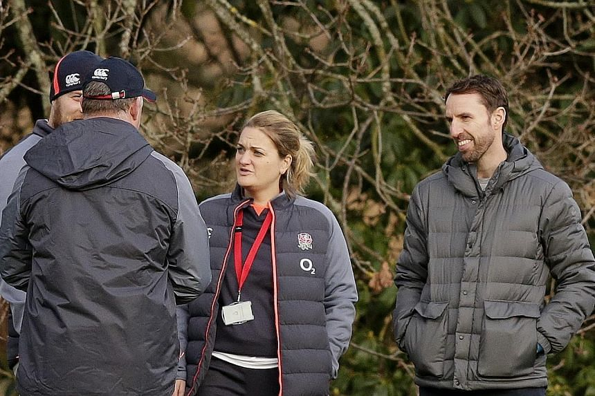 Above: England football manager Gareth Southgate was invited to share his expertise during training, with Eddie Jones hoping it will help his side conquer their nerves against Wales.