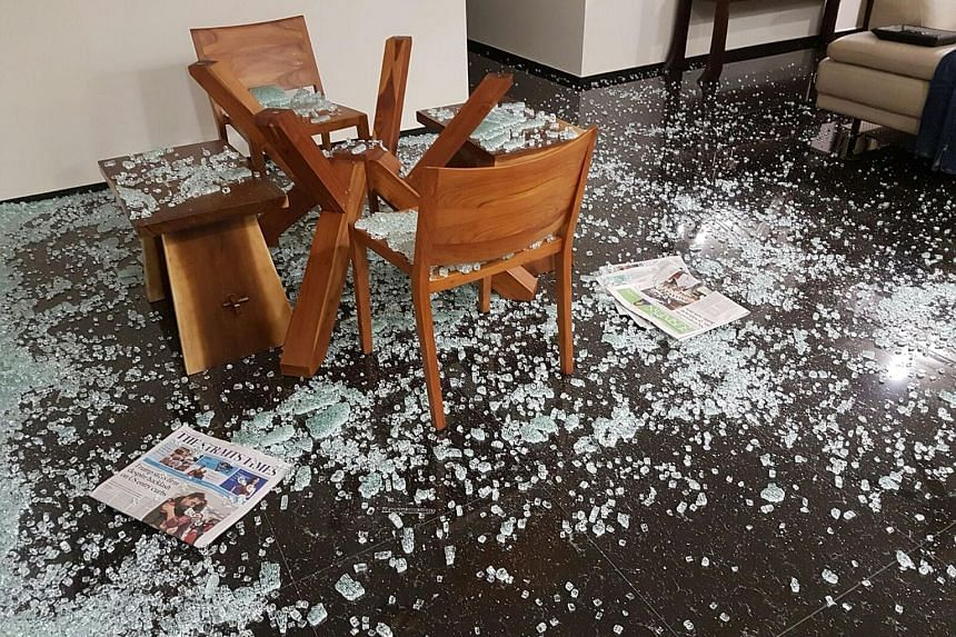 A mouldy wardrobe. SEE HOME B2 Ms Tan Li-Lin and her husband returned home from work last Tuesday to find this scene. It was only after checking their home for any burglary that they realised their dining table's glass top had shattered on its own.