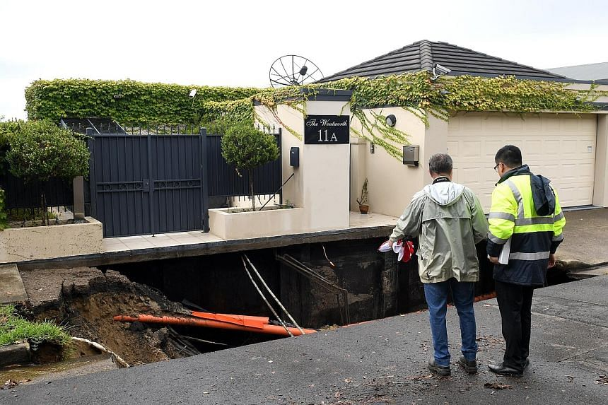 A sinkhole opened up less than a kilometre from Australian Prime Minister Malcolm Turnbull's home in the wealthy Sydney suburb of Point Piper, media said yesterday, after a night of heavy rain and flash floods. There were no reports of injuries or da