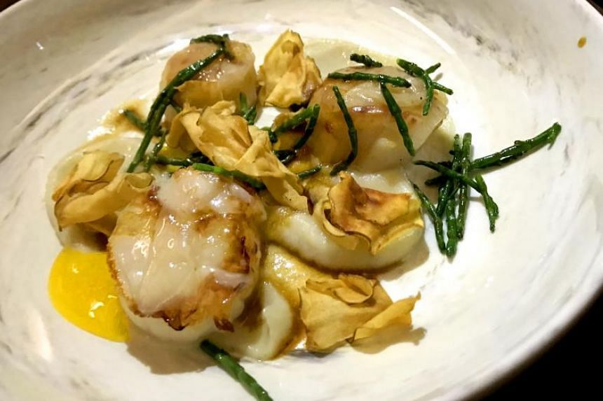 The scallops dish lacked personality.
