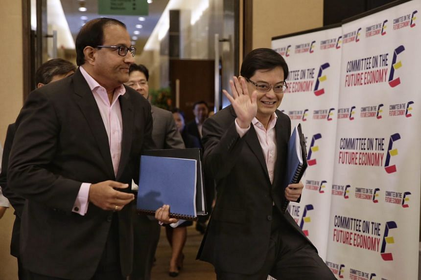 Finance Minister Heng Swee Keat (right) and Minister for Trade and Industry (Industry) S Iswaran arrive for the launch of the Committee on Future Economy's report on Feb 9, 2017.