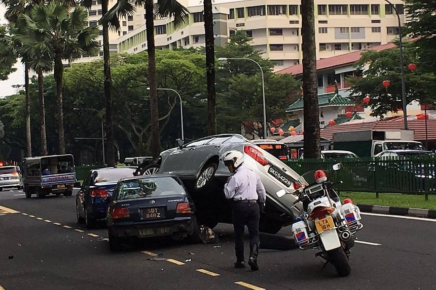 The collision, which resulted in the unusual sight, took place in the middle lane of the three-lane Sembawang Road, near Chong Pang Camp at around 7.30am on Thursday (Feb 9).