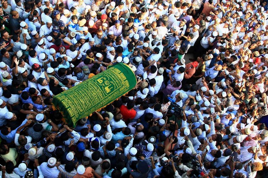Supporters carrying the coffin of prominent Muslim lawyer Ko Ni in Yangon, Myanmar, on Jan 30, 2017.
