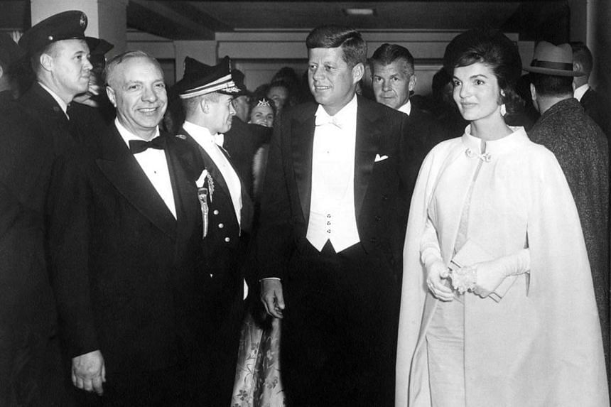 John F. Kennedy and Jacqueline Kennedy (right) arrive at the National Guard Armory for the inaugural ball in Washington, DC, US in January 1961.