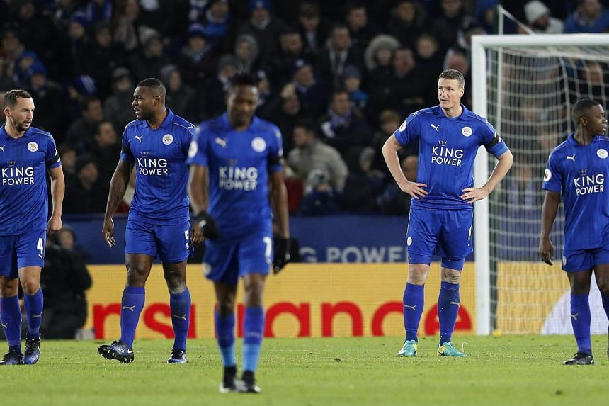 Leicester City's Danny Drinkwater, Wes Morgan, Robert Huth and Nampalys Mendy look dejected after Chelsea's Marcos Alonso scores their second goal.
