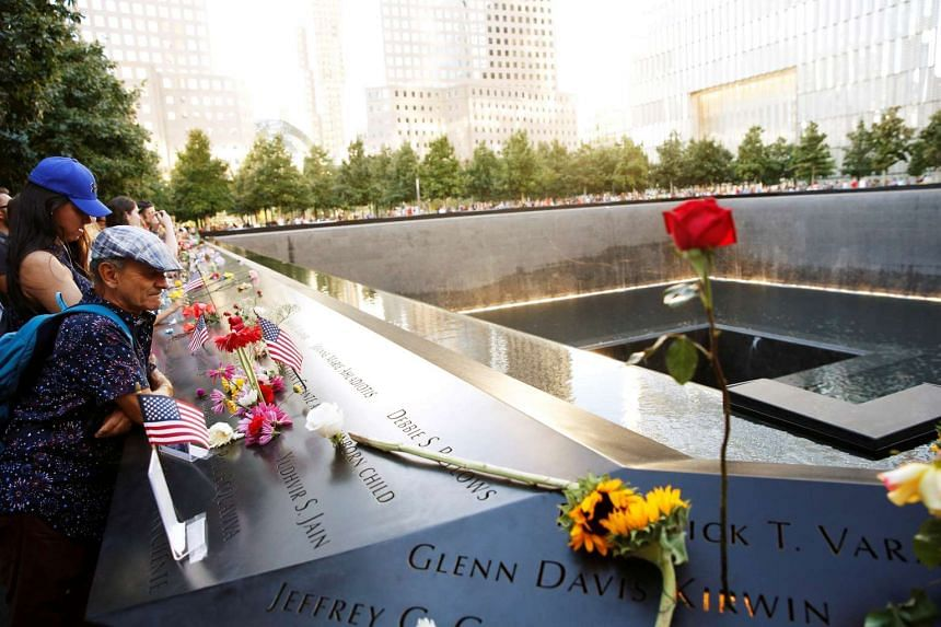 People looking out over the September 11 memorial and museum in New York on Sept 11, 2016.