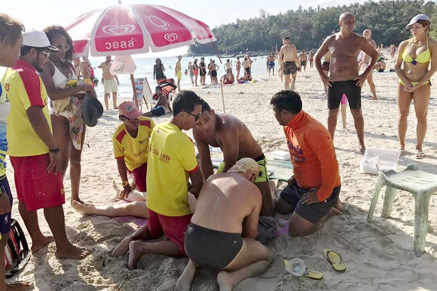 Foreign tourists and Thai lifeguards giving first aid to rescue Emily Jayne Collie after a jet ski accident on the resort island of Phuket on Feb 5, 2017.