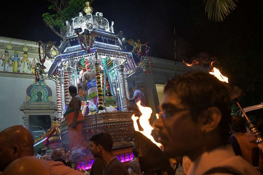 The chariot carrying Sri Murugan arrives back to the Sri Thendayuthapani Temple on the evening of Feb 8, 2017.