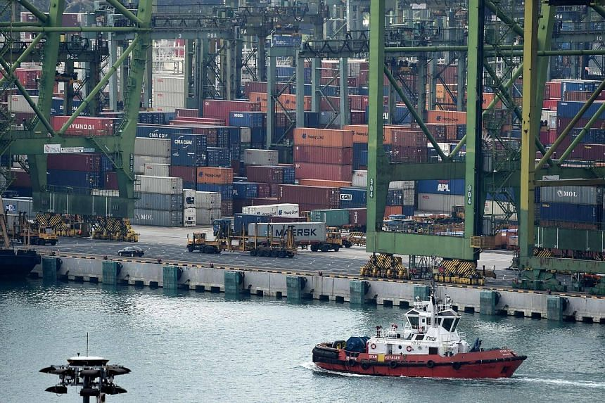 Trailer trucks ply along the passageway at Tanjong Pagar container port in Singapore.