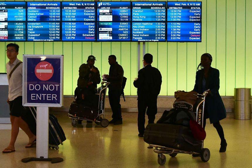 People arrive at the international terminal of Los Angeles International Airport on Feb 8, 2017, in Los Angeles, California.