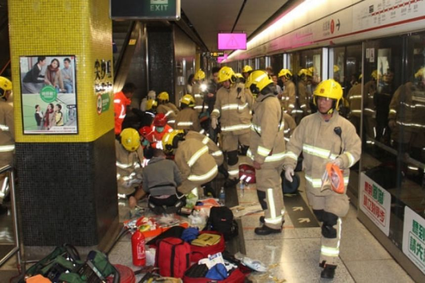Rescue workers tend to the injured after a fire at Hong Kong's Tsim Sha Tsui station on Friday (Feb 10).