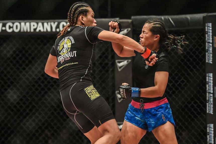 Singaporean MMA fighter Tiffany Teo defeats her opponent Priscilla Hertati of Indonesia at One Championship's event in Kuala Lumpur on Feb 10, 2017.