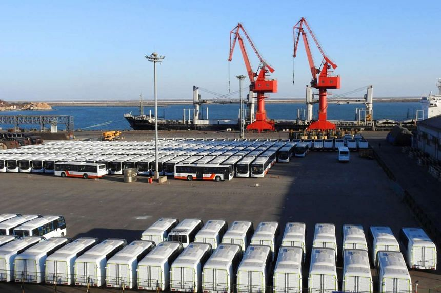Buses sit lined up at the docks waiting to be exported at a port in Lianyungang, in eastern China's Jiangsu province, on Jan 20, 2017.