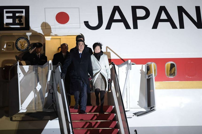 Japanese Prime Minister Shinzo Abe and his wife Akie arrive at Andrews Air Force Base in Maryland just outside Washington, DC on Feb 9, 2017.
